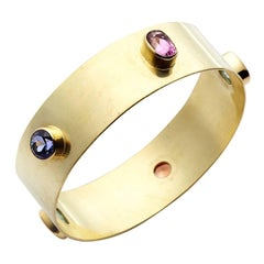 18kt Gold Bangle Garnet, Blue Zircon, Green Tourmaline, Tanzanite, Pink Sapphire