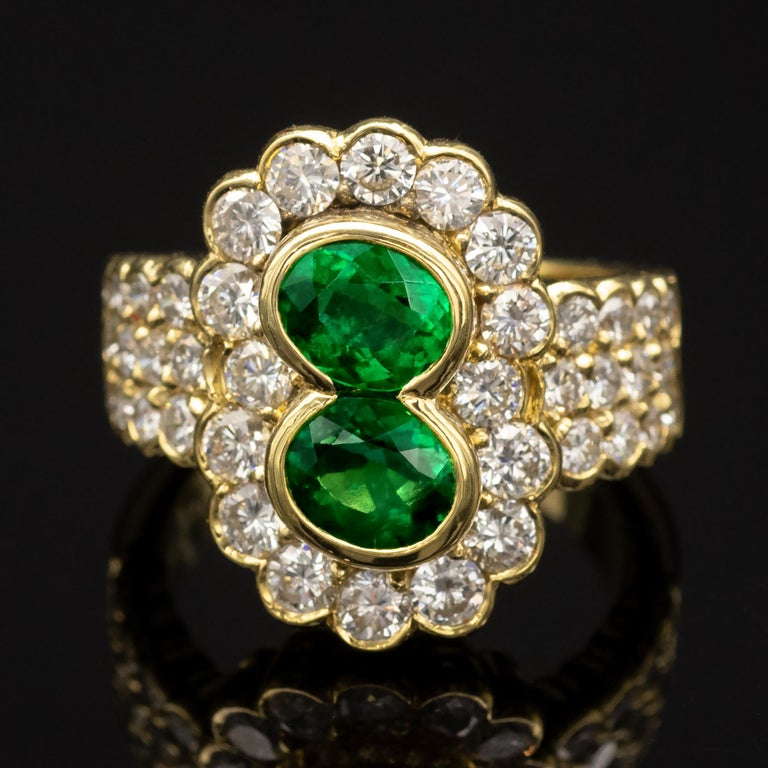 Oval Cut 18 Karat Gold Emerald and Diamond Ring For Sale