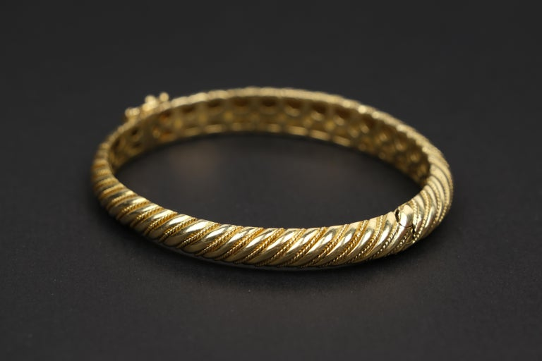 18 Karat Gold Torsade Bracelet- 30.5 grams of elegant 18kt.  I saw this at an estate auction and to be truthful the immediate attraction was the gold value.  Once I had obtained it, the auction was online, I appreciated the actual simple elegance of