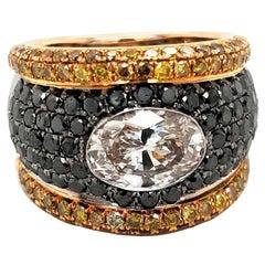 18Kt Golden Ring with Black & Fancy Cognac Diamonds, 2.31 Ct Large Oval Diamond