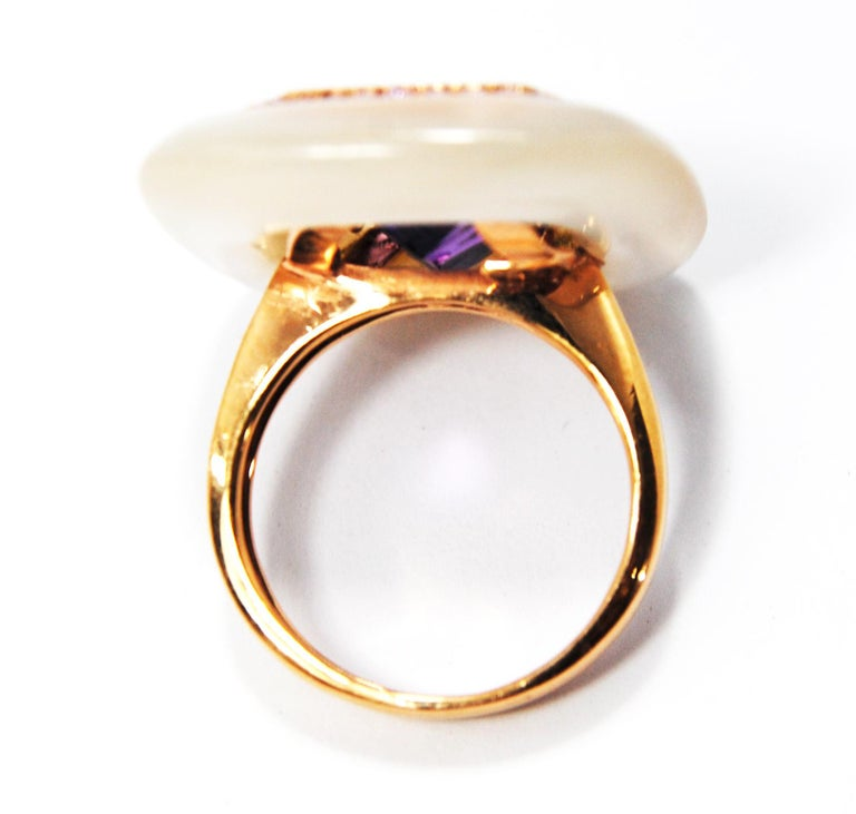 18 karat rose gold, amethyst and mother-of-pearl ring  The beautiful multifaceted amethyst measures 16mm x 12mm  and weights about 10ct  Size 14 Europe but can be adjusted