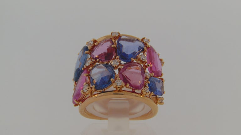 A Beautiful Modern Ring with 8 Rose cut freeform Sapphires in blue and pink hues totaling 10.40 Carats with .48 carats of Diamonds in between, all set on 18Kt Rose Gold.