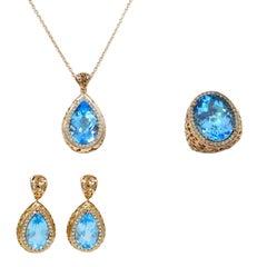 18 Karat Gold Blue Topaz and White Diamonds Garavelli Ring Earrings Pendant Set
