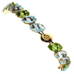 18kt Rose Gold with Peridot and Blue Topaz Bracelet