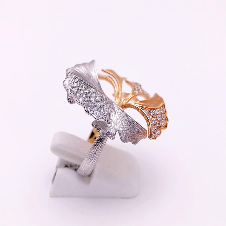 This beautiful Ginko Leaf ring is designed with 9 petals in a soft matte finish.  Four of the petals are set with 75  round brilliant diamonds. The leaves are detailed with veining. The combination of the rose and white gold with diamonds makes this