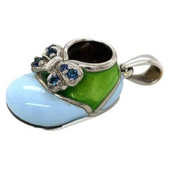 18KT WG Baby Shoe Charm with .16Ct Blue Sapphire Green & Blue Enamel with Bow