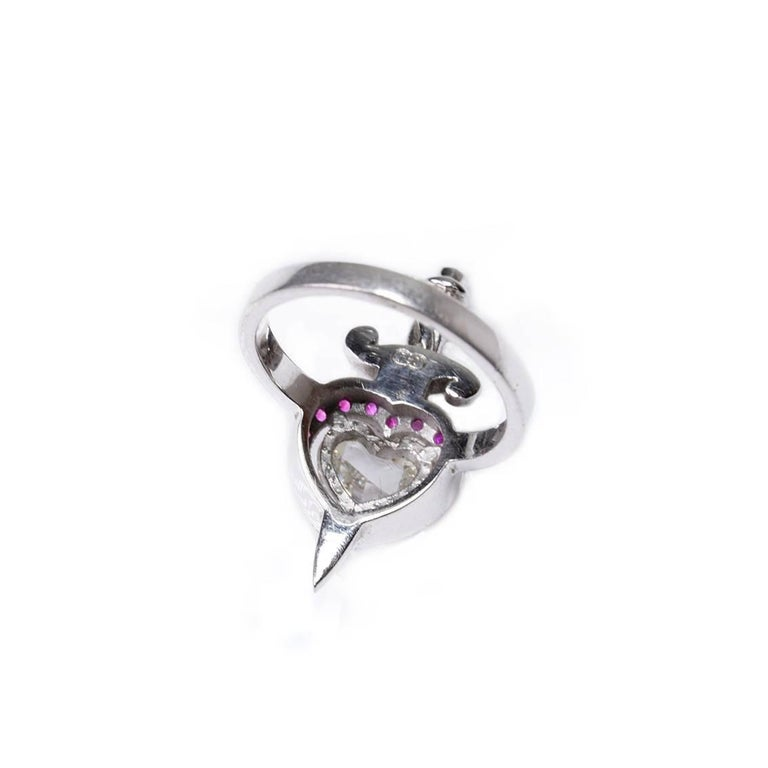 This Heart & Dagger Ring is an exquisite piece. The perfect ode to love and romance, this stunning ring is unique and timeless. Handmade in 18kt white gold this enchanting ring features a central, heart shaped, rose cut diamond, 0.70ct in weight, VS