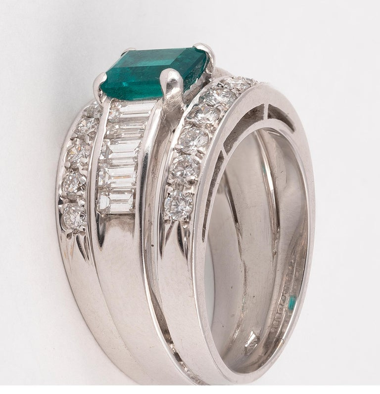 Emerald rectangular cut approximately 1ct with baguette and round diamond. Approximately diamonds 1,95ct. Approximately  Weight: 12gr. Size: 7