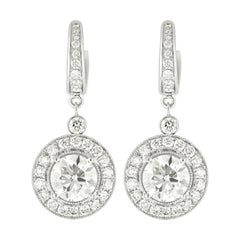 18kt White Gold Earrings with Round Diamonds Center