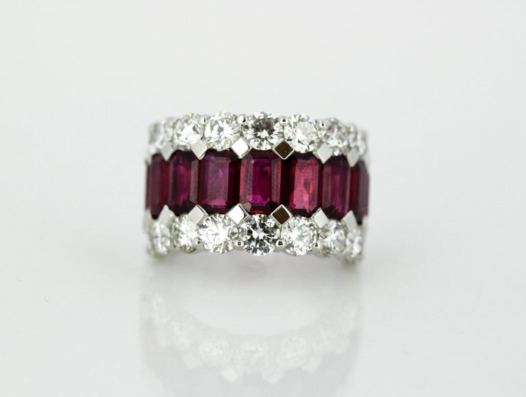 18kt white gold ladies half eternity ring with natural burmese rubies and stunning diamonds Hallmarked 750.  Dimensions -  Weight : 12 grams Finger Size (UK) = M (US) = 6 1/2 (EU) = 52 1/2 Size : 2.3 x 2 x 1.4 cm   Ruby -  Cut : Octagon Number of