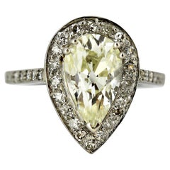 18 Karat White Gold Ladies Ring with Pear Cut Intense Light Yellow Diamond 1980s