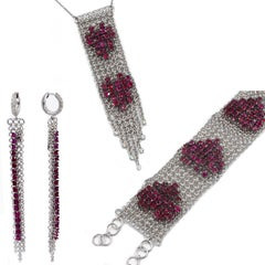 18 Karat White Gold Rubies and Diamonds Garavelli Bracelet Earrings Pendant Set