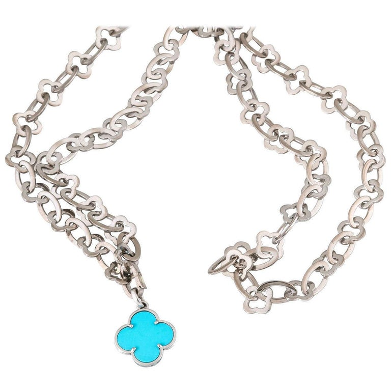 A wonderfully discontinued 32 inch 18Kt white gold chain by Van Cleef & Arpels. The Turquoise color is now discontinued as well as the chain. The weight of the chain is 103 grams. Serial number BL 30349 bears French maker's mark. The Clover was