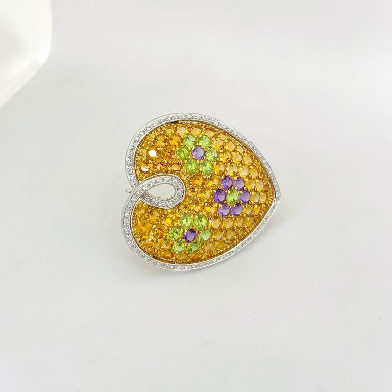 sterling silver with a yellow Sapphire Dalmatian Heart brooch
