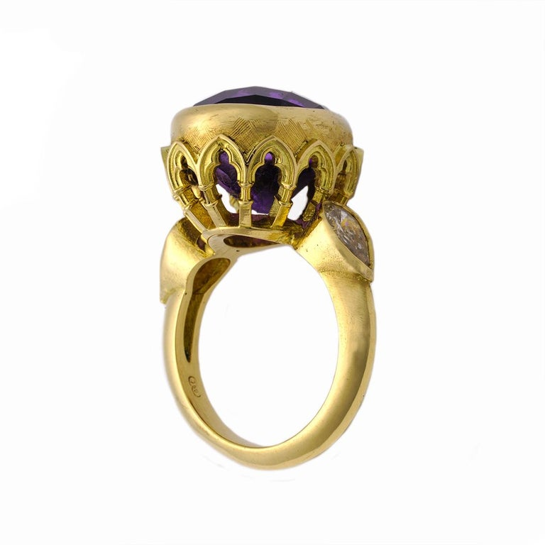 This fascinating ring titled The Vivid Splendor Ring is an absolutely magnificent, one of a kind piece and fits a size.   Handmade in 18kt yellow gold, the ring features an oval checkerboard cut amethyst, approximately 18.25ct in weight and deep