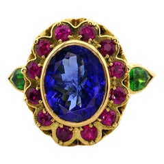 18kt Yellow Gold, 6.00ct Tanzanite, 0.75ct Ruby and 0.50ct Tsavorite Garnet Ring