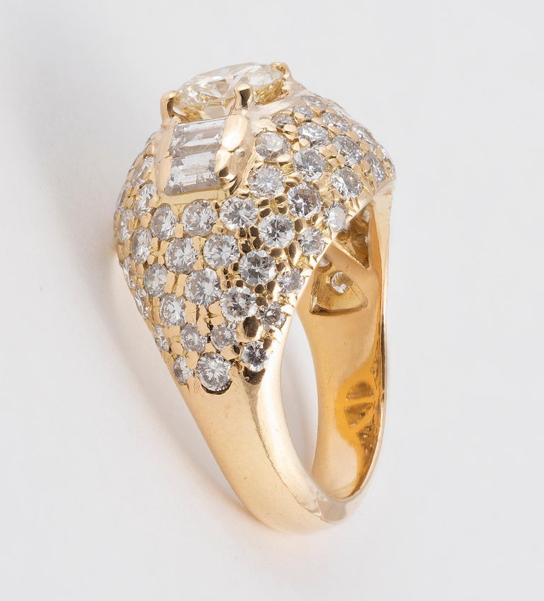 Baguette Cut 18 Karat Yellow Gold and Diamond Bombe Ring For Sale
