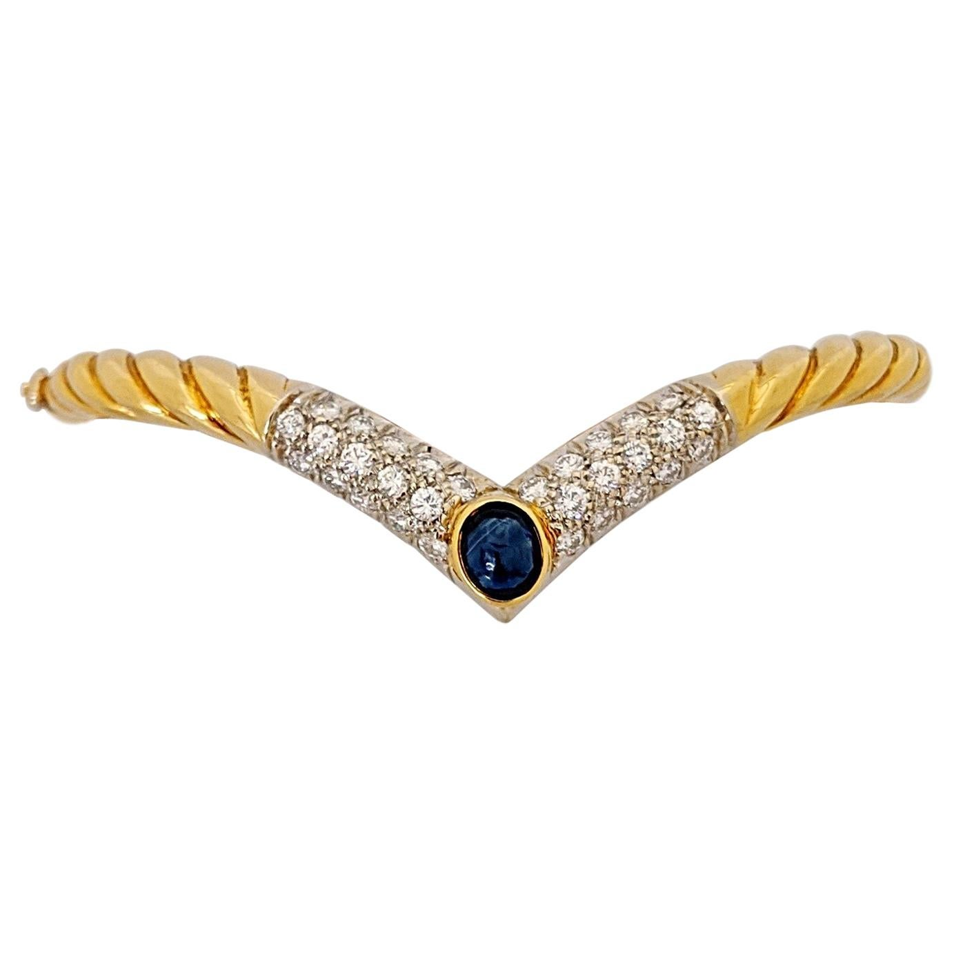 18KT Yellow Gold Bangle Bracelet with 1.26CT. Diamonds & 1.Ct. Cabochon Sapphire