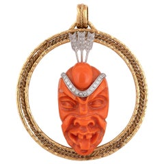 18 Karat Yellow Gold Carved Mask Diamond Pendant