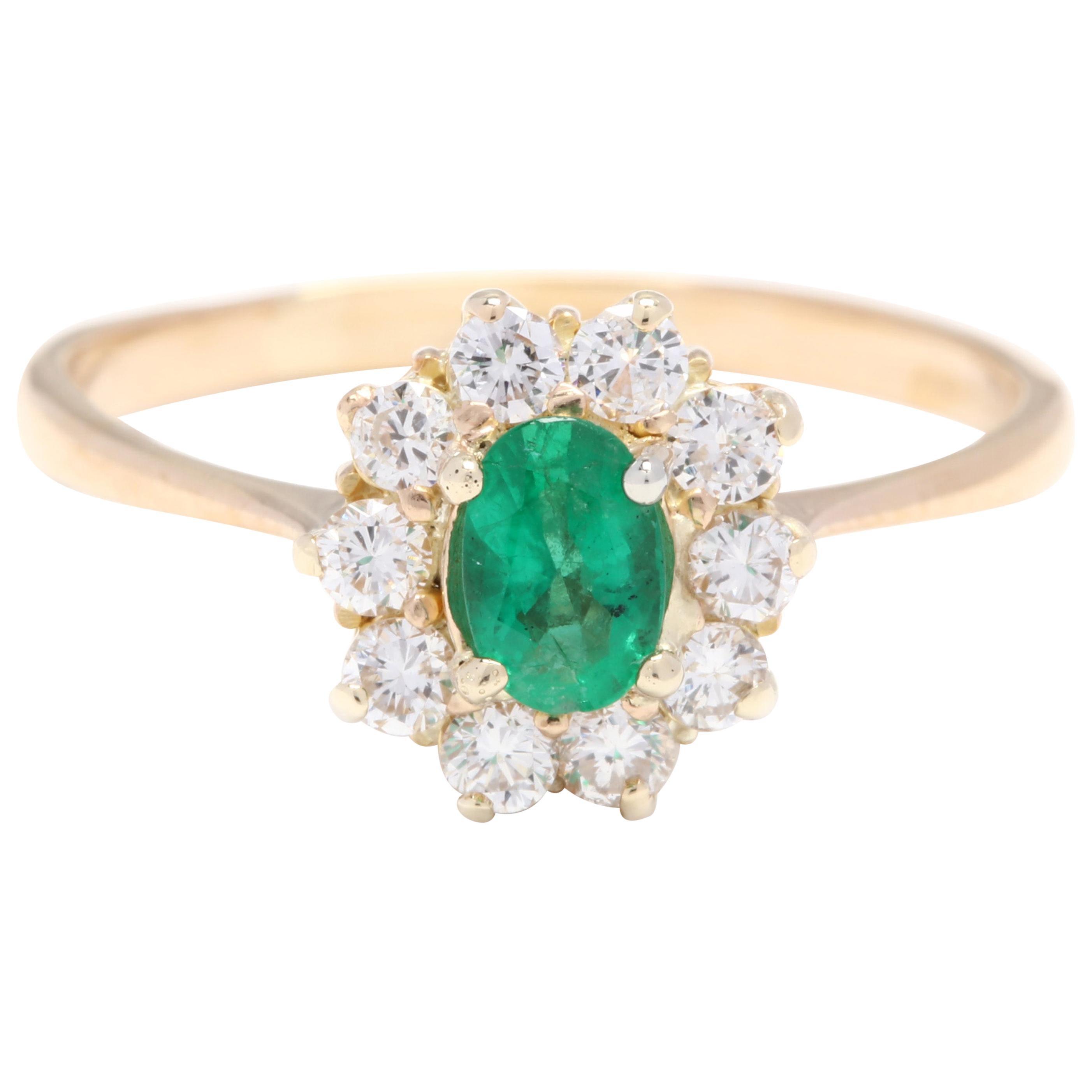18 Karat Yellow Gold, Emerald and Diamond Halo Ring