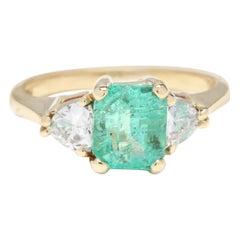 18 Karat Yellow Gold, Emerald and Trillion Diamond Three-Stone Ring