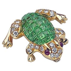 18 Karat Gold Frog Brooch with Invisibly Set Tsavorites, Diamonds, and Rubies