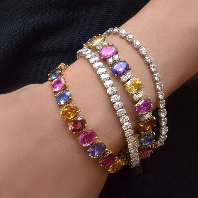 Contemporary 18 Karat Gold Multicolored Oval Sapphires 49.95 Carat and Diamonds Bracelet For Sale