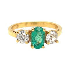 18kt Yellow Gold Oval 57ct. Emerald and .46ct. Diamond Ring
