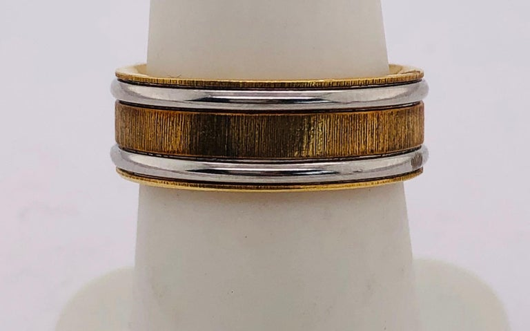 18Kt Yellow Gold and Platinum Ring in a Satin Finish Size 6.5 with 10.4 grams total weight. Change the tag to 226