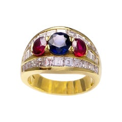18 Karat Gold Ring, 1.53 Carat Oval Blue Sapphire, with Rubies and Diamonds