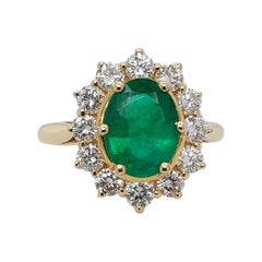 18kt Yellow Gold Ring with 1.75ct Emerald and 1.20ct Diamonds