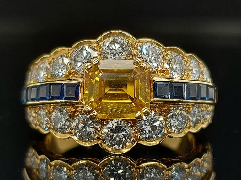 18 Karat Yellow Gold Ring with Large Yellow Sapphire Blue Sapphires and Diamonds For Sale 8