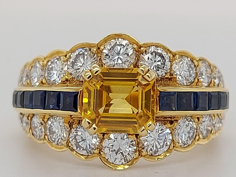 18 Karat Yellow Gold Ring with Large Yellow Sapphire Blue Sapphires and Diamonds For Sale 10
