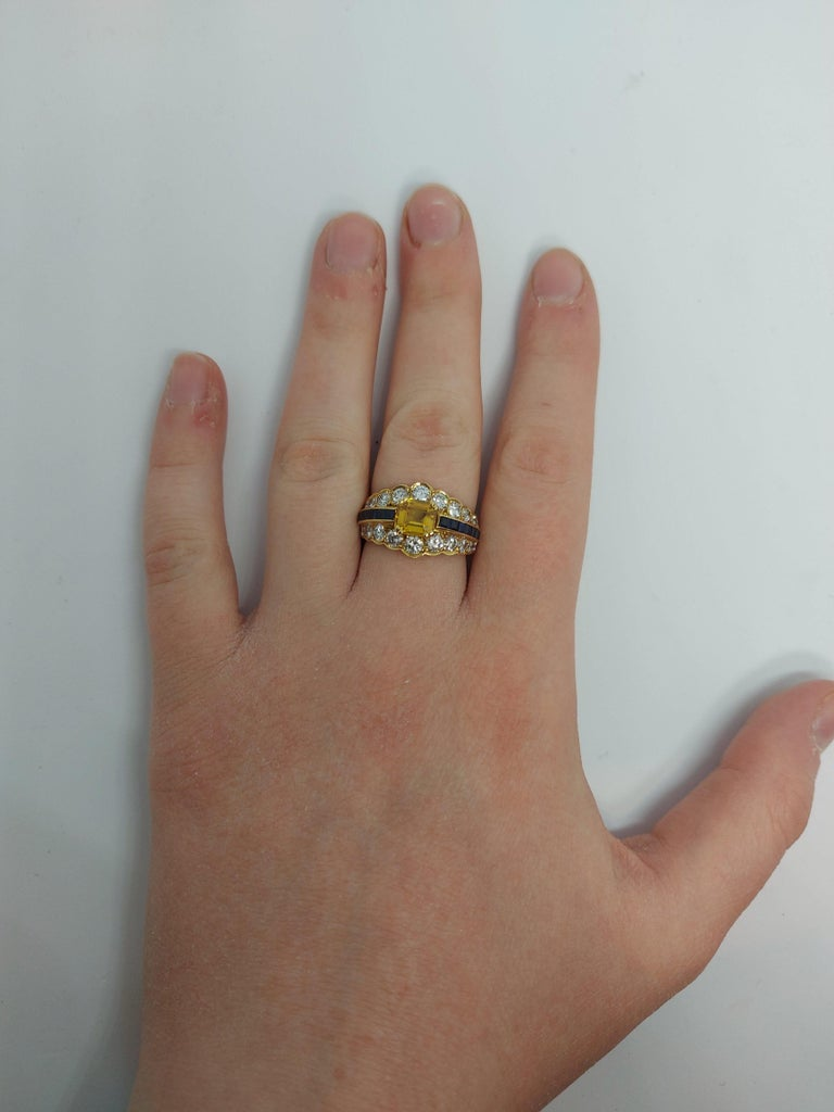 18 Karat Yellow Gold Ring with Large Yellow Sapphire Blue Sapphires and Diamonds For Sale 11