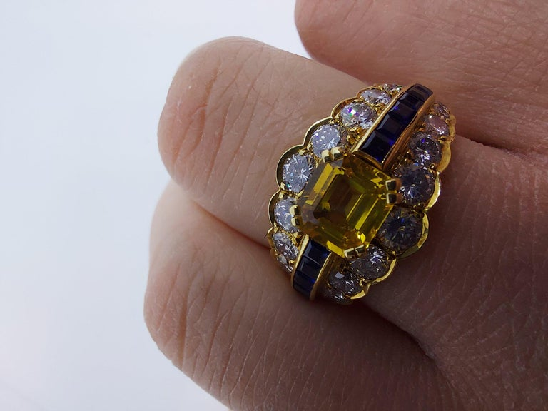 18 Karat Yellow Gold Ring with Large Yellow Sapphire Blue Sapphires and Diamonds For Sale 12