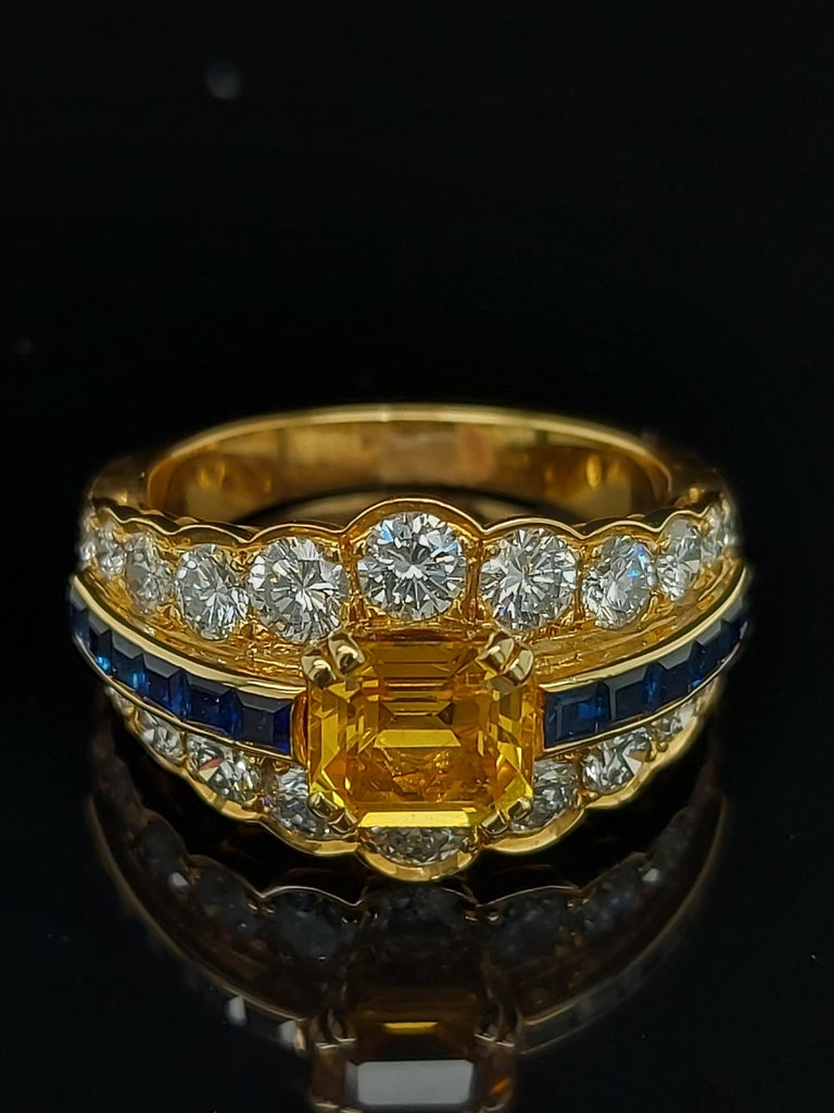 Artisan 18 Karat Yellow Gold Ring with Large Yellow Sapphire Blue Sapphires and Diamonds For Sale