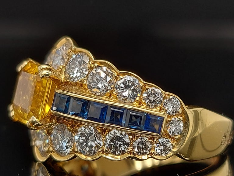 Women's or Men's 18 Karat Yellow Gold Ring with Large Yellow Sapphire Blue Sapphires and Diamonds For Sale