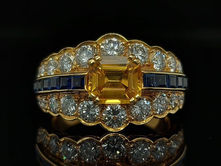 18 Karat Yellow Gold Ring with Large Yellow Sapphire Blue Sapphires and Diamonds For Sale 2