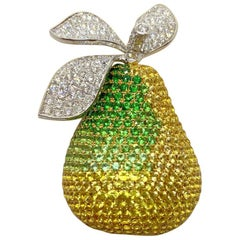 18 Karat YG & WG Pear Brooch with Diamonds, Yellow Sapphires and Tsavorites