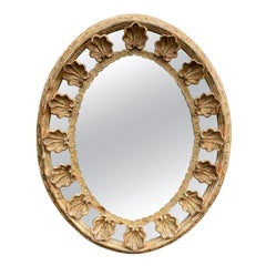 18th-19th Century Italian Oval Carved Giltwood Shell Mirror with Label