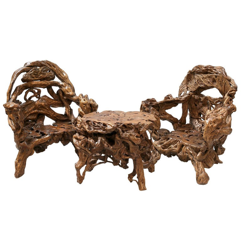 18th and 19th Century Chinese root wood art chairs and table set  The set consists of two chairs and a table. These groupings were often given as gifts. Root wood carving and polishing is a traditional Chinese art form.  These groupings consisted of