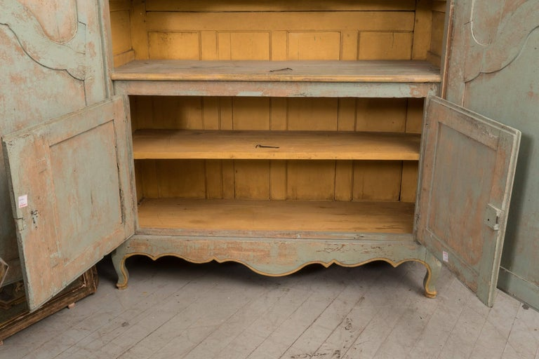 This is a very rare Bordelaise Armoire with an interior buffet. Original paint with a beautiful patina.