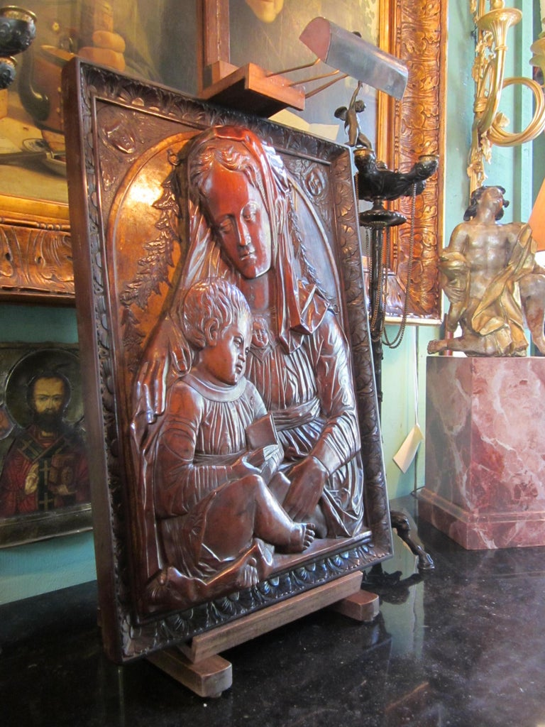 "A large beautifully 18th century carved relief fruitwood partially gilt of "" Madonna AND CHILD"" , Italian. Important craftsmanship with the finely carved in high relief from one panel with the feel of depth through the three-dimensional carving. The"