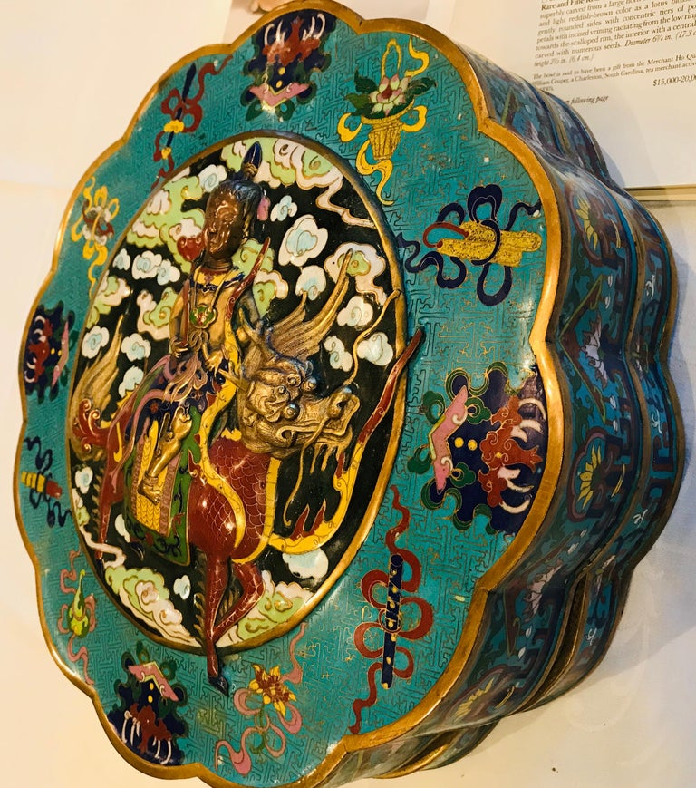 This highly detailed, multi-metal Qing Dynasty cloisonné box features a raised design in bronze and copper, depicting an Emperor-Warrior mounted on a horse with a dragon head. The emperor's face is copper, where the dragon head and horse-tail are