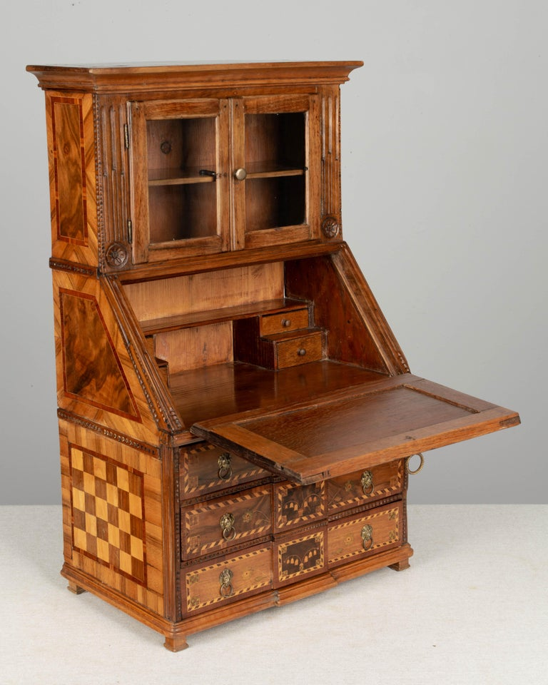 An exquisite 18th century French Louis XVI miniature mahogany and walnut marquetry secretaire, or scriban. Beautifully made with bold checkerboard pattern on the sides, three dovetailed drawers decorated with inlaid lily of the valley and tiny brass