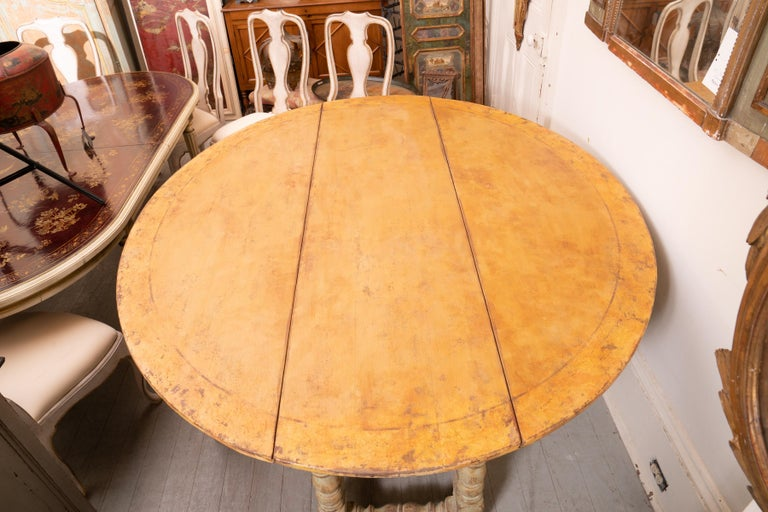 Italian country Gateleg harvest table with leather surface. Beautiful patina and structurally sound table with a fantastic structure. The carved legs support a wonderfully worn and patinated leather work surface. The versatility of this table and
