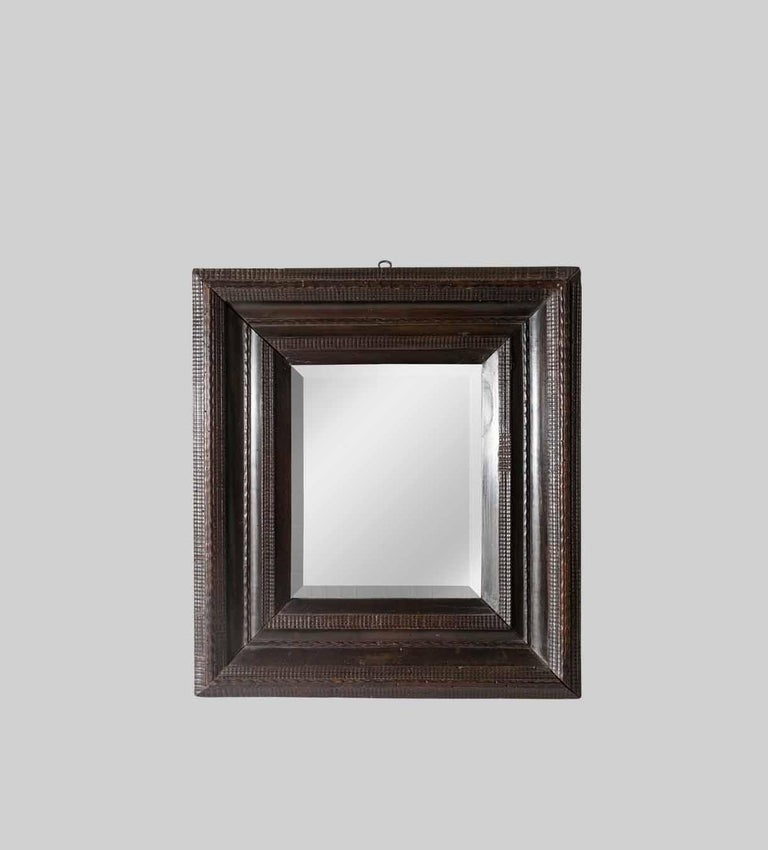 European 18th Century Italian Walnut Ebonized Mirror with Finely Carved Guilloche Detail