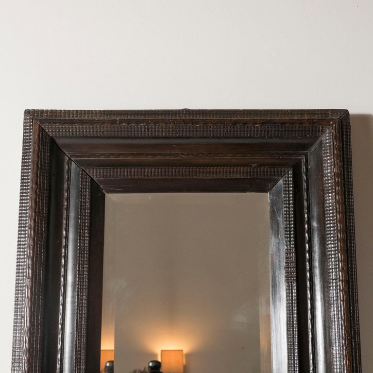 18th Century Italian Walnut Ebonized Mirror with Finely Carved Guilloche Detail In Good Condition In Brooklyn, NY