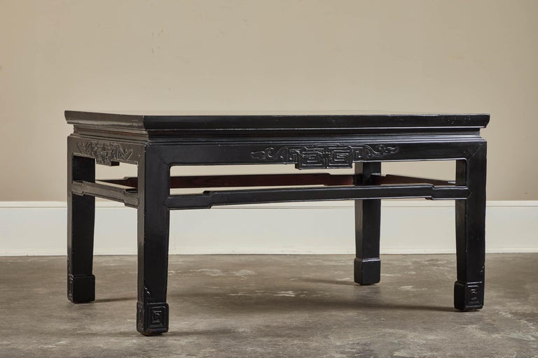 An 18th century low black lacquer kang table from Shanxi, China. Unusual in size.