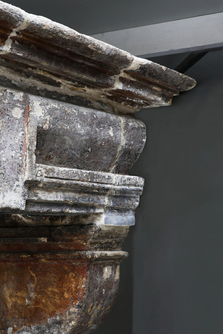 Impressive antique castle fireplace from the 18th century in the style of Louis XIII. We are proud on this beautiful castle fireplace in our collection. The wide top, the lines, the patinae and the size ensure that this fireplace is a valuable piece